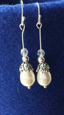 Silver with Swarovsky pearl $15